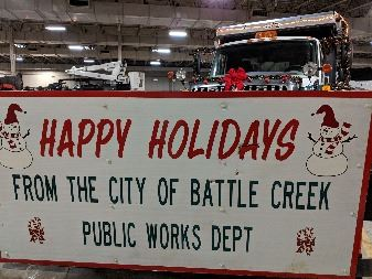 Plow truck Happy Holidays sign