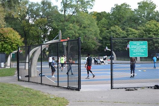 Basketball play on a nice day at Claude Evans Park, North Washington Avenue.