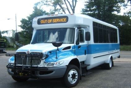 A white and blue public bus